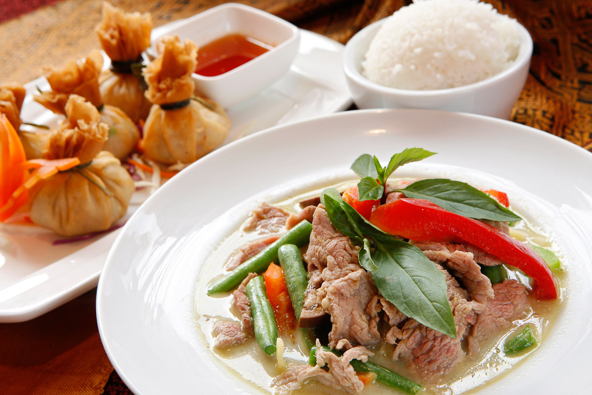 The green curry with beef and golden bags appetizer at Erawan Thai restaurant in Philadelphia.