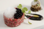 Beef tartare with balsamic vinegar spheres and caper {quote}air{quote} at Bocca restaurant in Philadelphia.