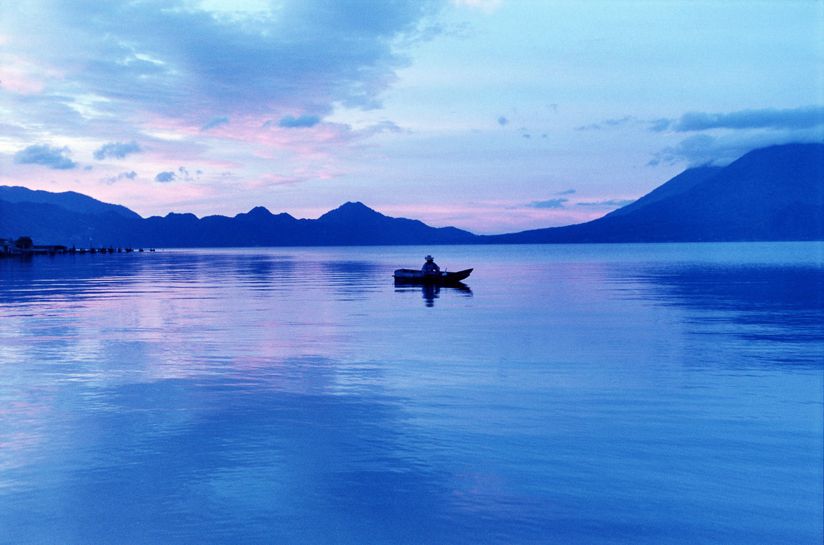 A fisherman at dawn on Lake Atitlán, Guatemala.