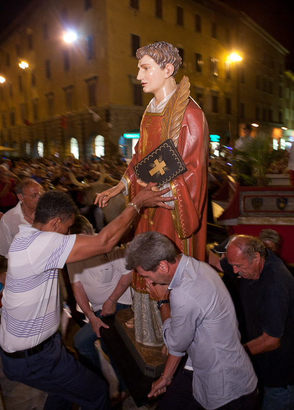 Men carry the patron saint of Grosseto into the Cathedral of San Lorenzo during the festival of San Lorenzo in Grosseto, Tuscany.