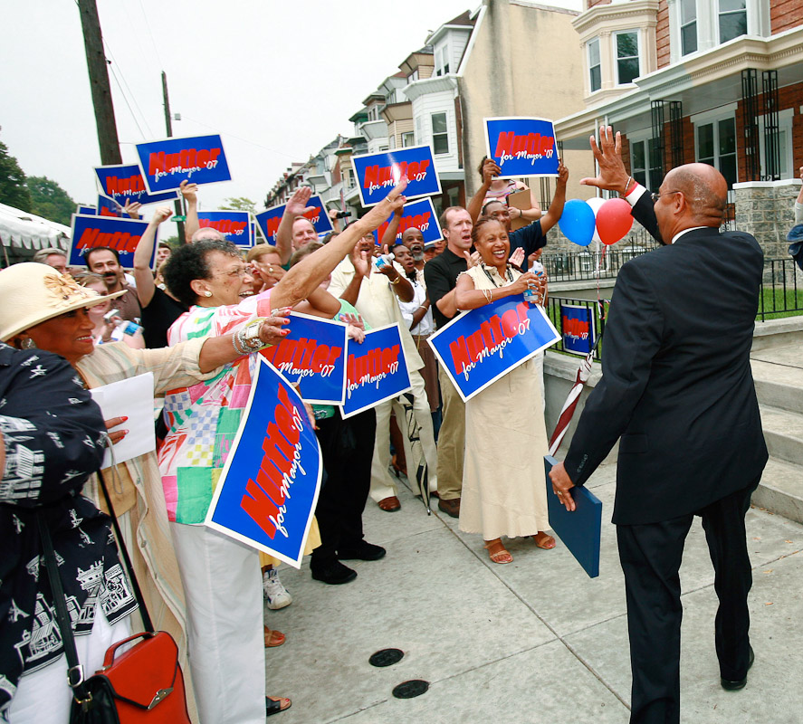 Democrat Michael Nutter and former member of Philadelphia city council, right, arrives at the home of Diane Marshall in West Philadelphia to announce that he is officially running for mayor of the city in the next mayorial election, 2006.