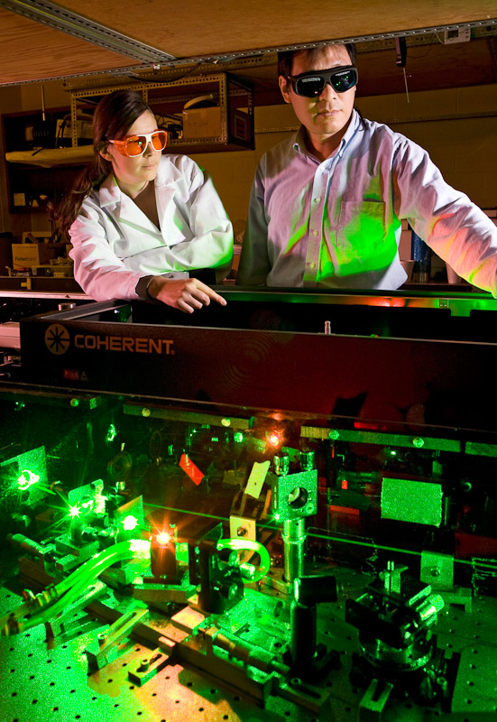 Researcher Jianxin Chen, right, and post-doc Diana Camila Urbanek use ultra-fast laser spectroscopy to explore the dynamic structure of protein folding at the University of Pa. in Philadelphia.