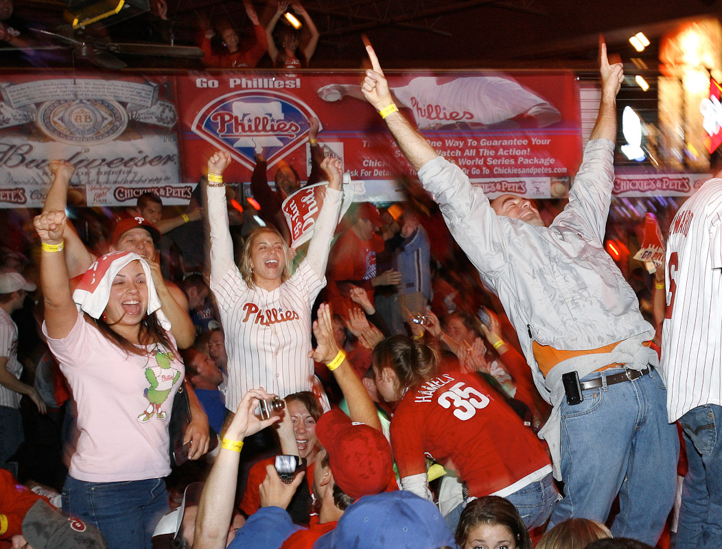Phillies fans celebrate their team's victory moments after the final out of the 2008 World Series at Chickie's and Pete's bar and restaurant several blocks from the stadium in South Philadelphia Wednesday, Oct. 29, 2008.