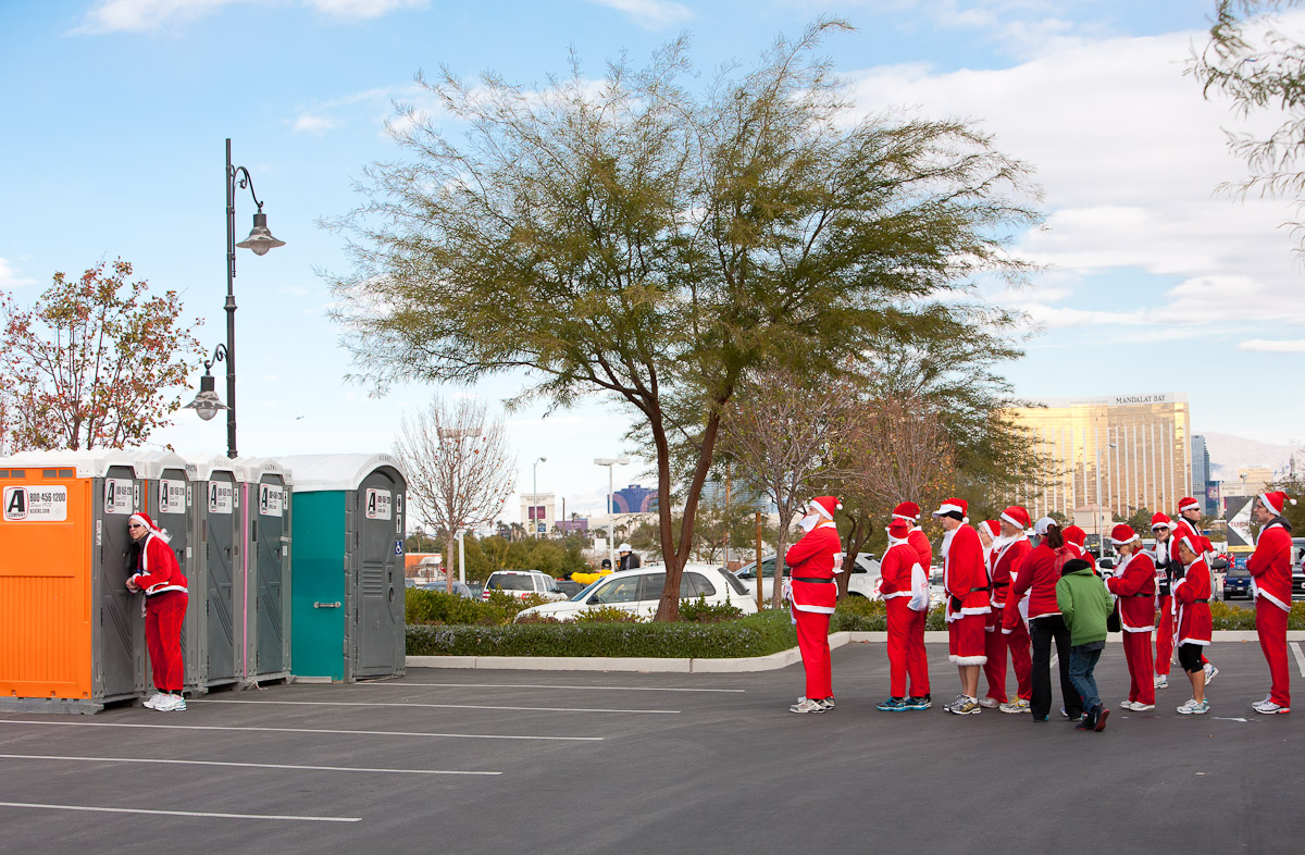 Santas line up for the restroom before the Santa Claus 5K in Las Vegas, NV.