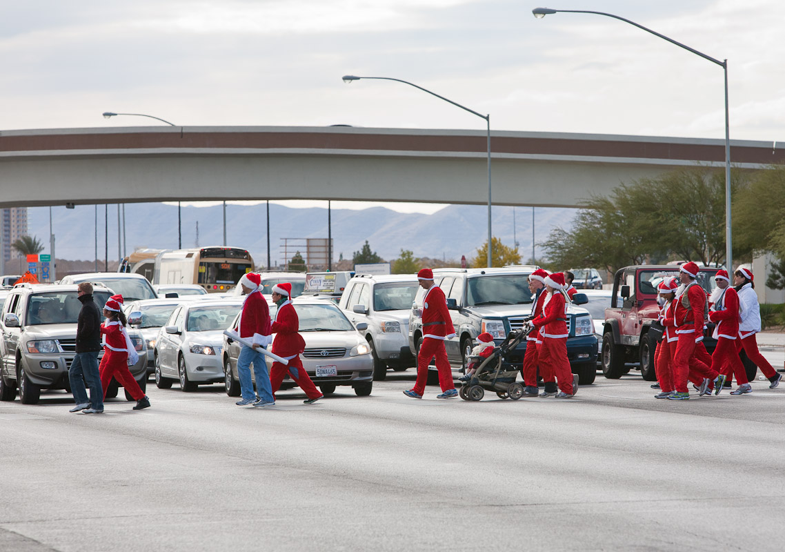 Santas cross a highway following the Santa Claus 5K in Las Vegas, NV.