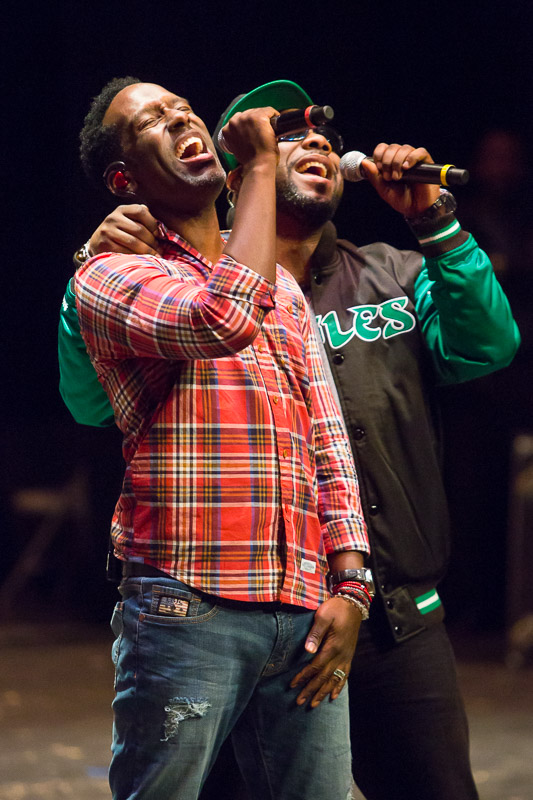 Boyz II Men members Shawn Stockman, left, and Wanya Morris, perform with the group for students at The Philadelphia High School for the Creative & Performing Arts, the high school where the R&B group began.