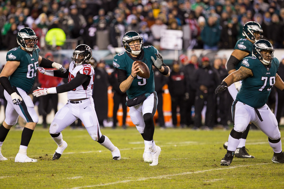 Nick Foles, QB for the Philadelphia Eagles, looks to pass during a playoff matchup against The Atlanta Falcons at Lincoln Financial Field.