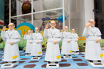 Pope Francis figurines populate a storefront in Philadelphia.