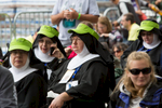 A group of nuns wait for mass led by Pope Francis to begin on the Ben Franklin Parkway in Philadelphia.