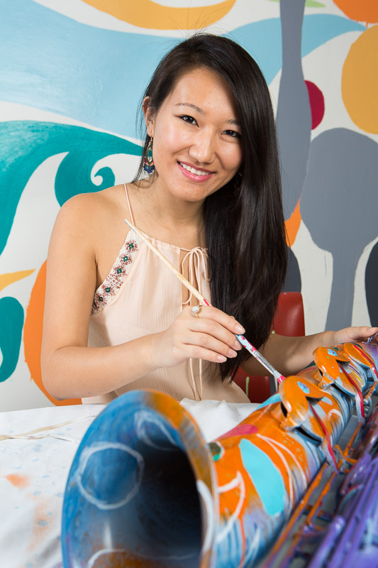University of Pa. student Amy Wu paints a baritone saxophone at the Platt Rehearsal Building.