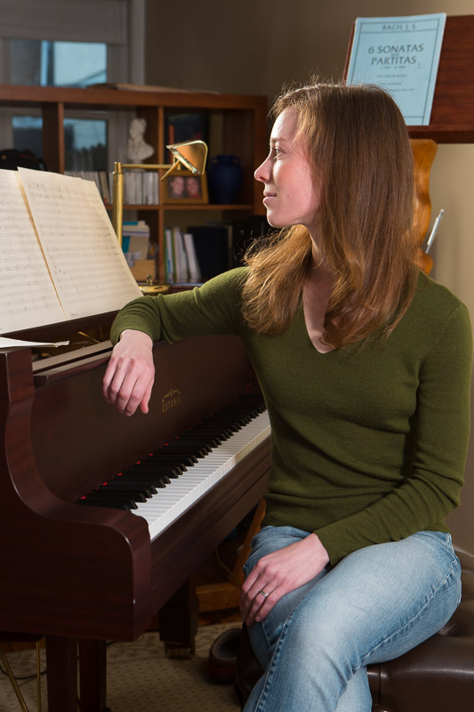 Composer and PhD. student at the University of Pa. Erica Ball at her piano in Philadelphia.