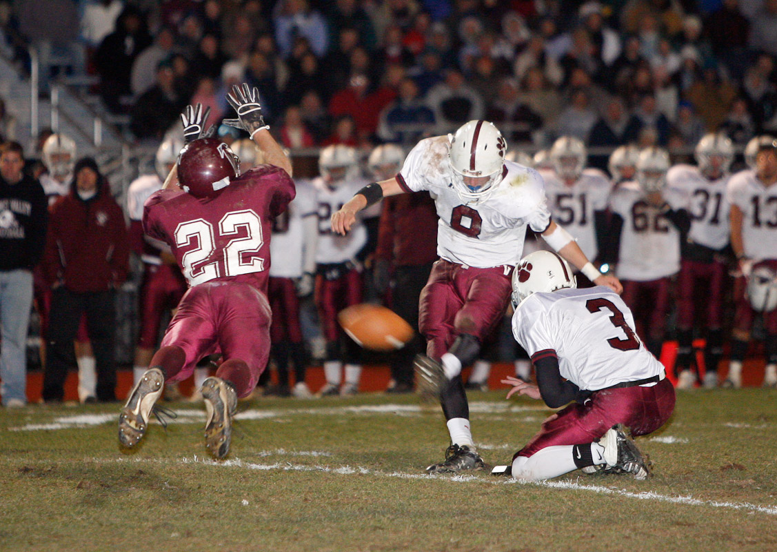 Senior Steve Nissley of Pottsgrove High, left, blocks a field goal attempt by senior Eric Van Wyk of Garnet Valley at the end of the first half in a District I Class 3A title game at Pottsgrove High in Pottstown, Pa.