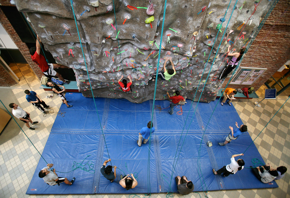 Wharton students participate in a rock-climbing workshop at the Potruck Center at the University of Pa.