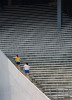 Erin Katims, in yellow shirt, a former tennis coach, and Jessy Smith, a former assistant gymnastics coach, both for the University of Pa., exercise at Franklin Field on the campus in Philadelphia by doing stair repetitions.