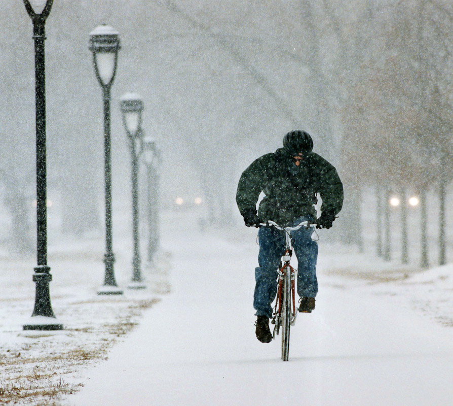 A cyclist pedals through a heavy snowstorm in Philadelphia.