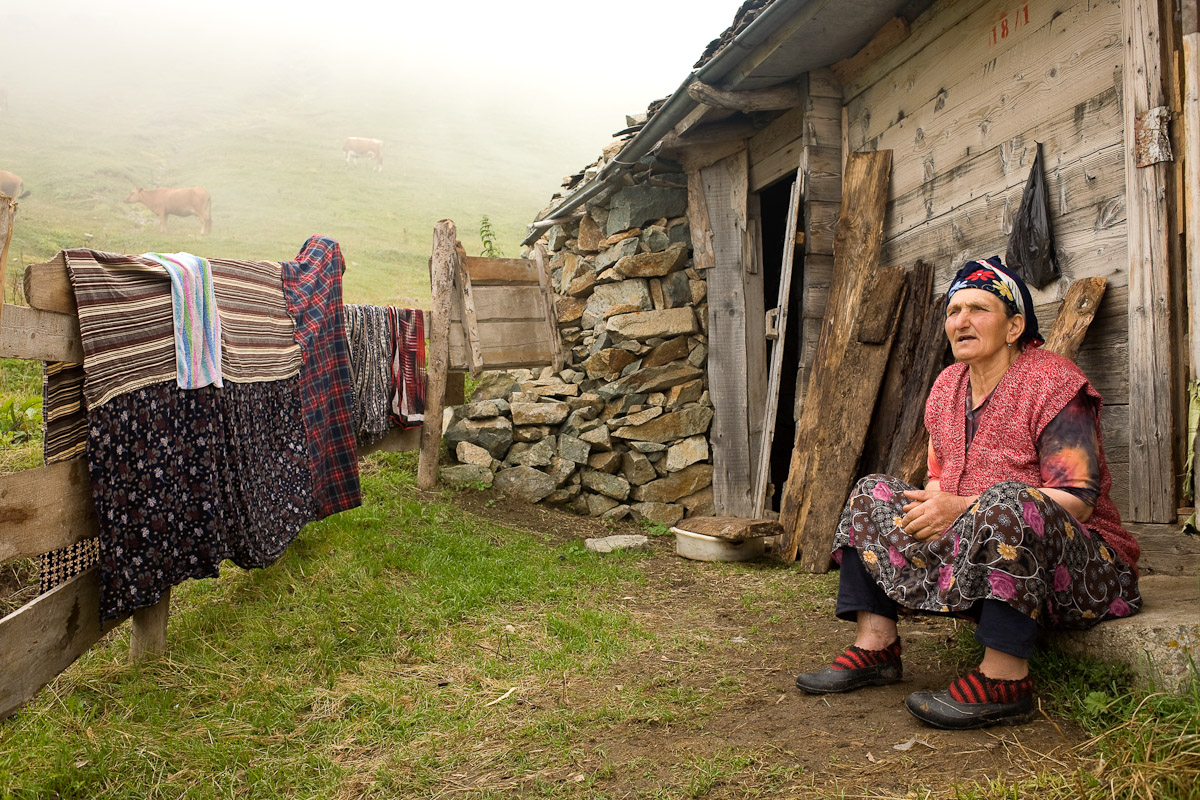 A woman sits on her doorstep in the high plateaus near Uzungöl, Turkey.