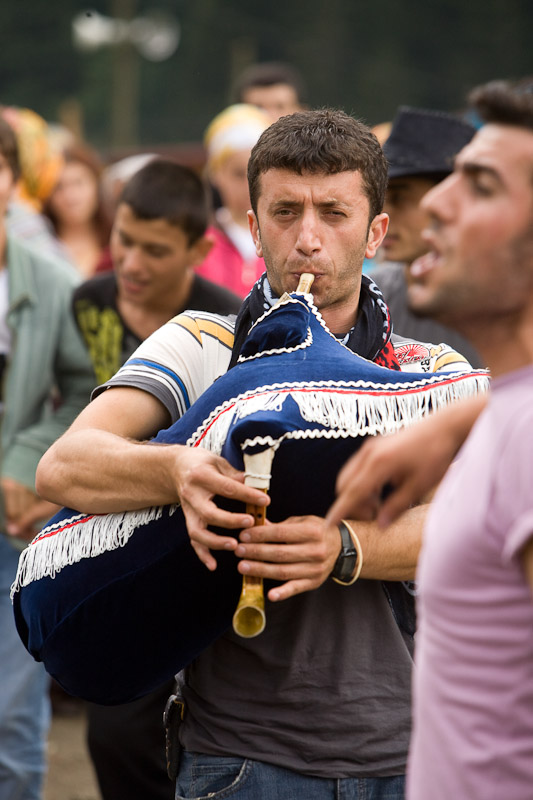 A bagpiper leads a horon dance in the mountainous town of Ayder, Turkey.