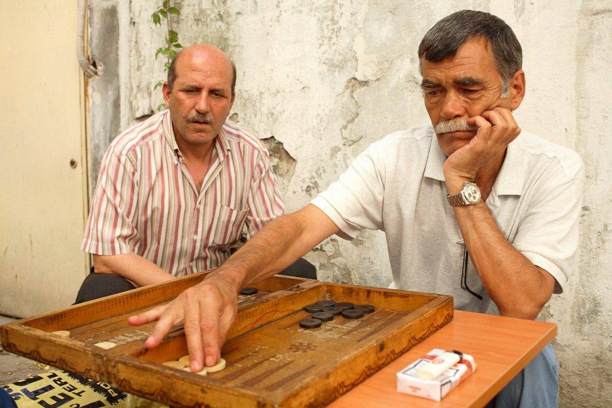 Men play backgammon in Istanbul, Turkey.