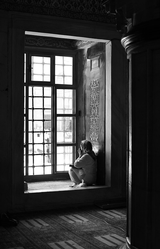 A woman prays inside the Blue Mosque in Istanbul, Turkey.
