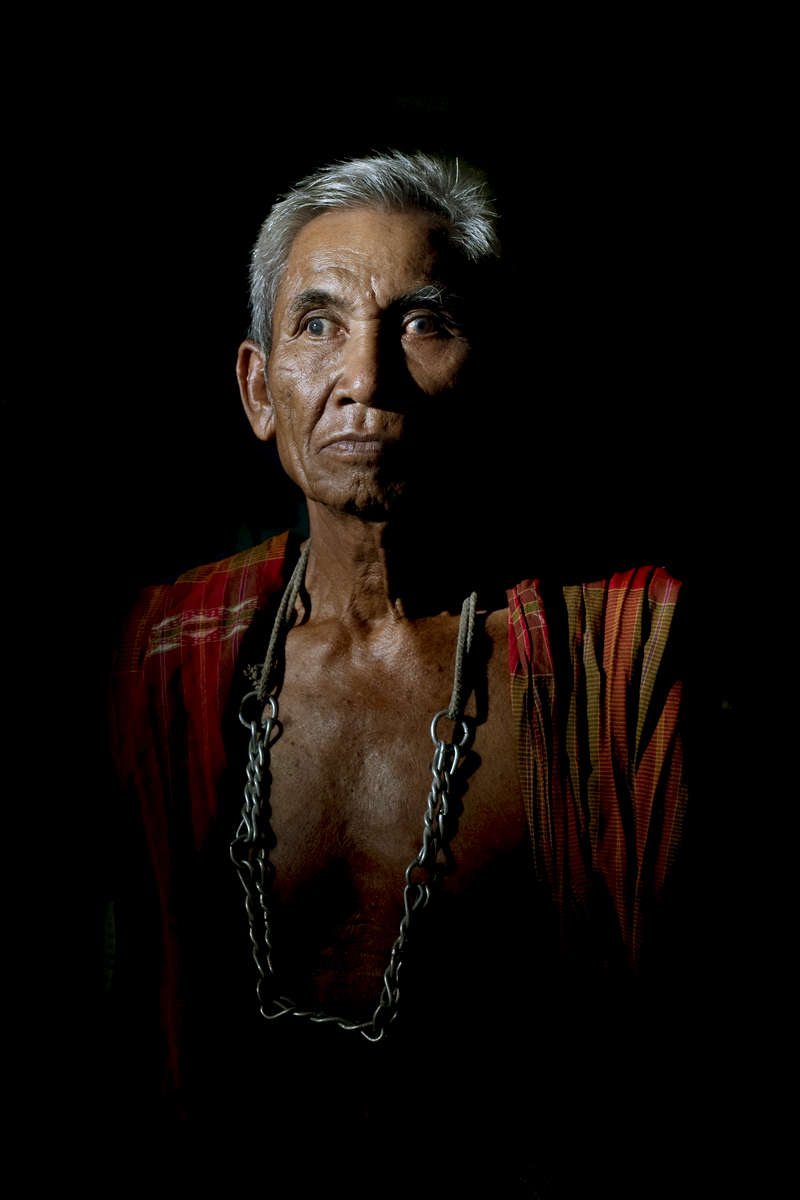 Ma Sandee, a Mor Chang, or elephant shaman, poses in Ban Ta Klang. He is one of the last 4 remaining Mor Chang and a spiritual leader of the Kui people.