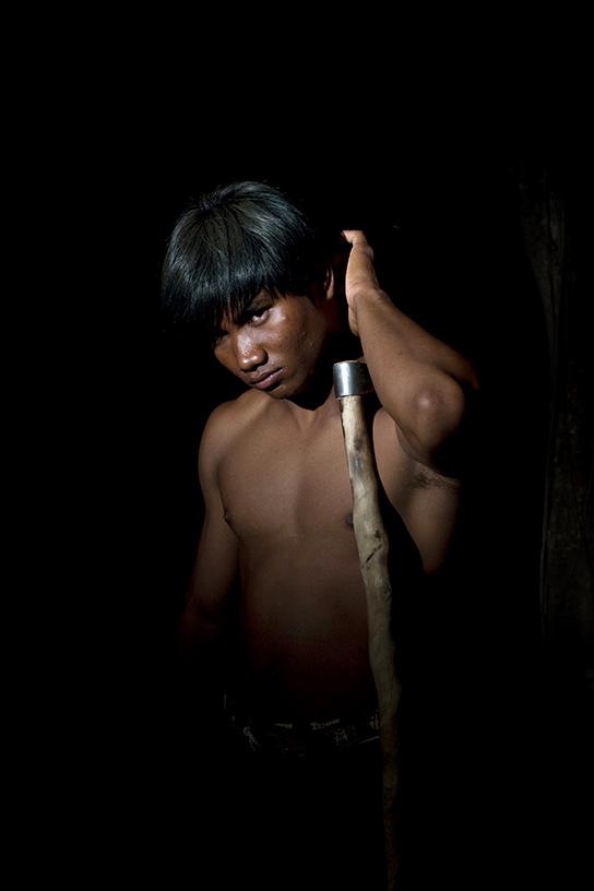 Boon Choi poses in the village of Ban Ta Klang.