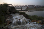 Waste from an open sewar drains in a tributarty of the Ganges river in Moradabad, India.