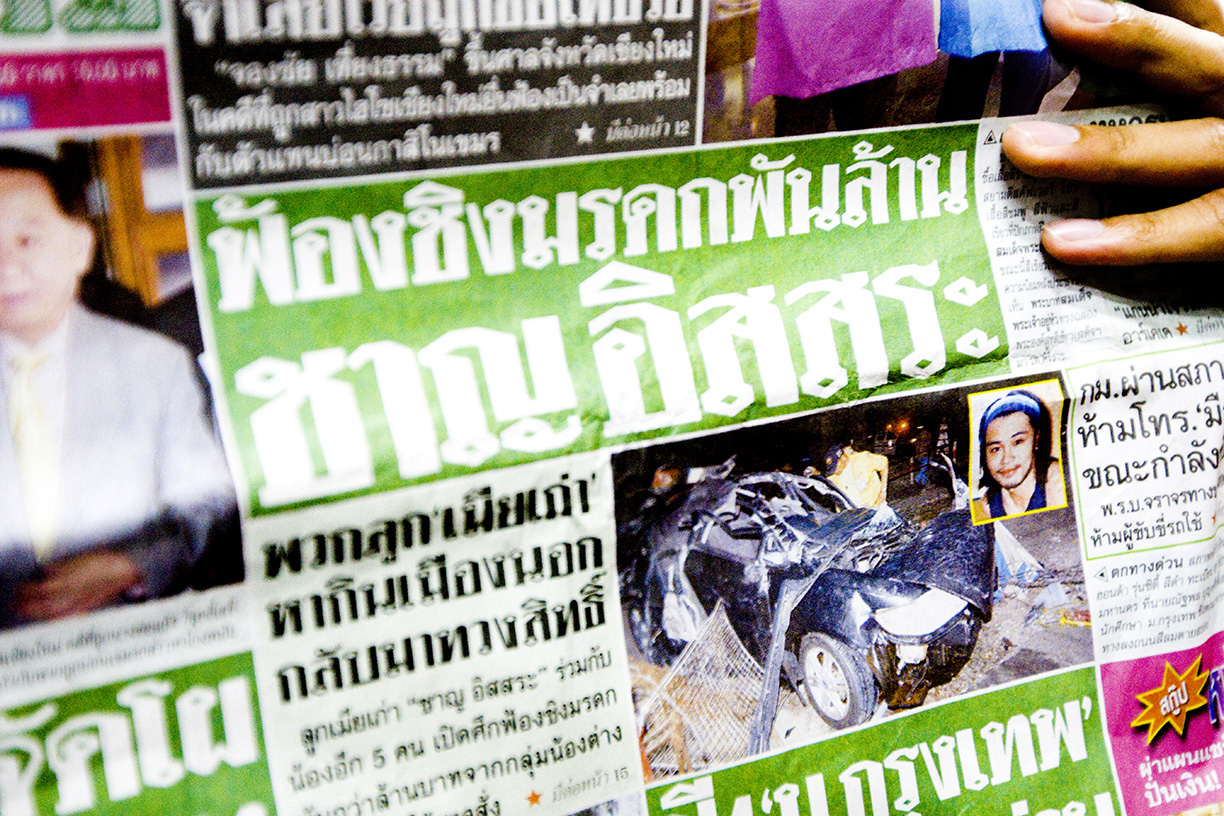 A photo of a car accident and the deceased is found on the front page of a Thai newspaper. Graphic photos of car accidents are common in Thai newspapers