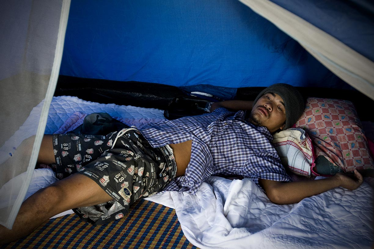 Mahout Pui wakes up at a temporary camp near Rama 9 road in Bangkok.