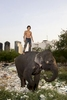 Mahout Bang poses with elephant Beepoe at a temporary camp in Bangkok.