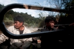 Loggers hitch a ride into Hongsa to purchase supplies in Lao PDR.