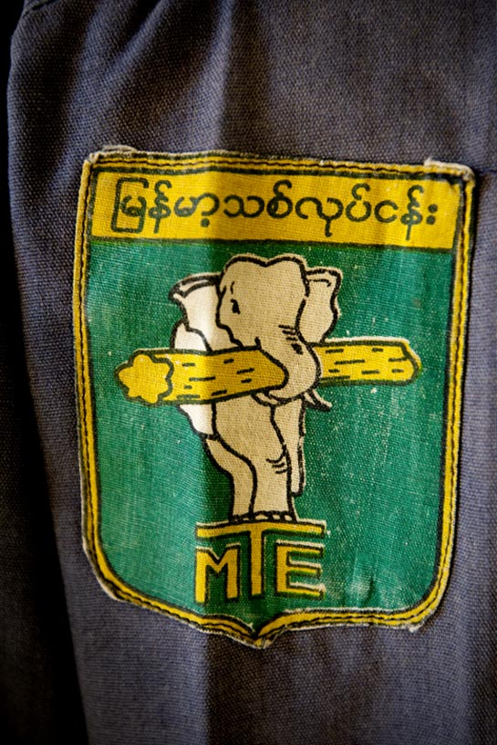 The government run Myanmar Timber Enterprise (MTE) logo is stitched to a loggers shirt.