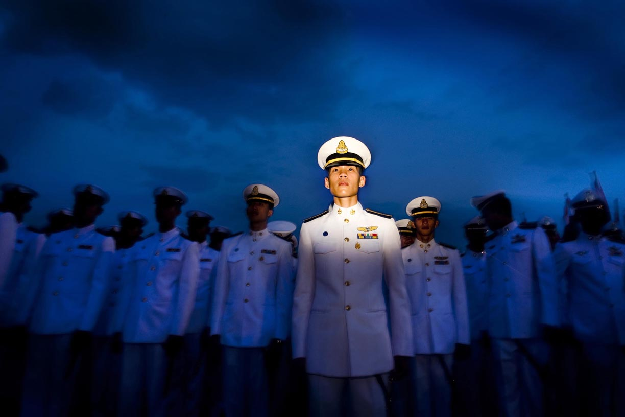 Members of the Royal Thai Navy stand on guard during a celebration for the King of Thailand's birthday in Bangkok, Thailand.