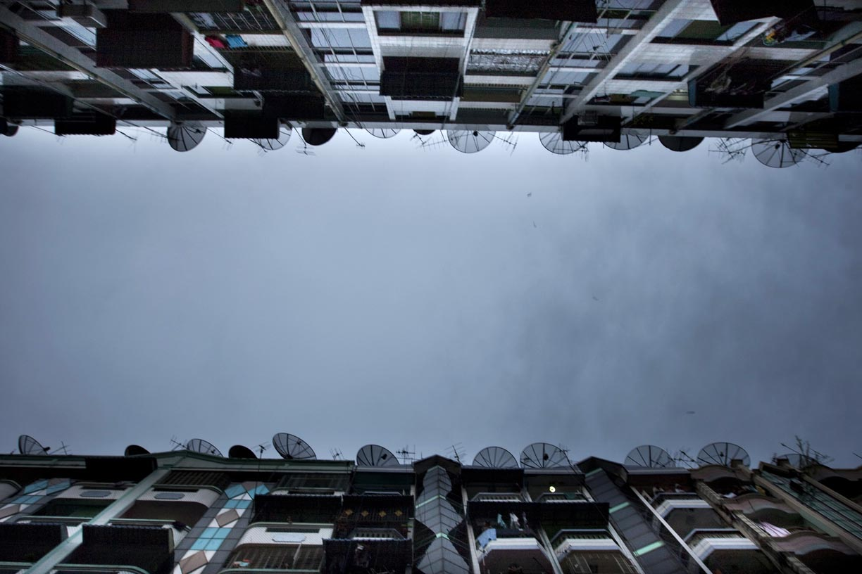 Television satellites line the roof of upscale apartments in Rangoon. Satellite tv is highly expensive for all but a small minority of residents as the government imposes an annual registration fee of one million kyats ($1000 USD)