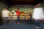 Visitors pass a lying Buddha at Shwedagon Pagoda.