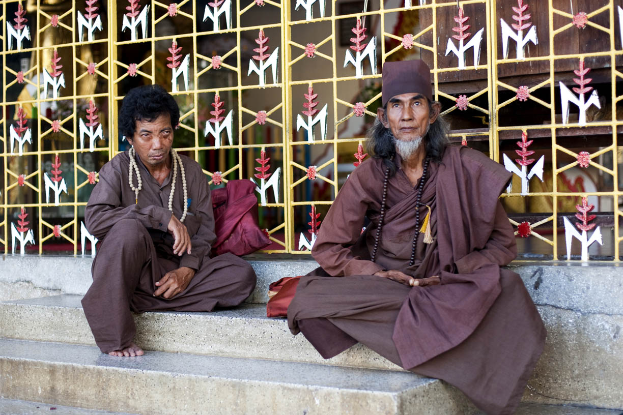 Holy men pose for a photo at Botataung Paya.