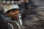 A young labourer carries coal on his head in the Jaintia Hills.