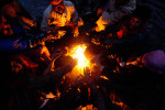 Coal miners huddle around a fire to keep warm in the Jaintia HIlls.
