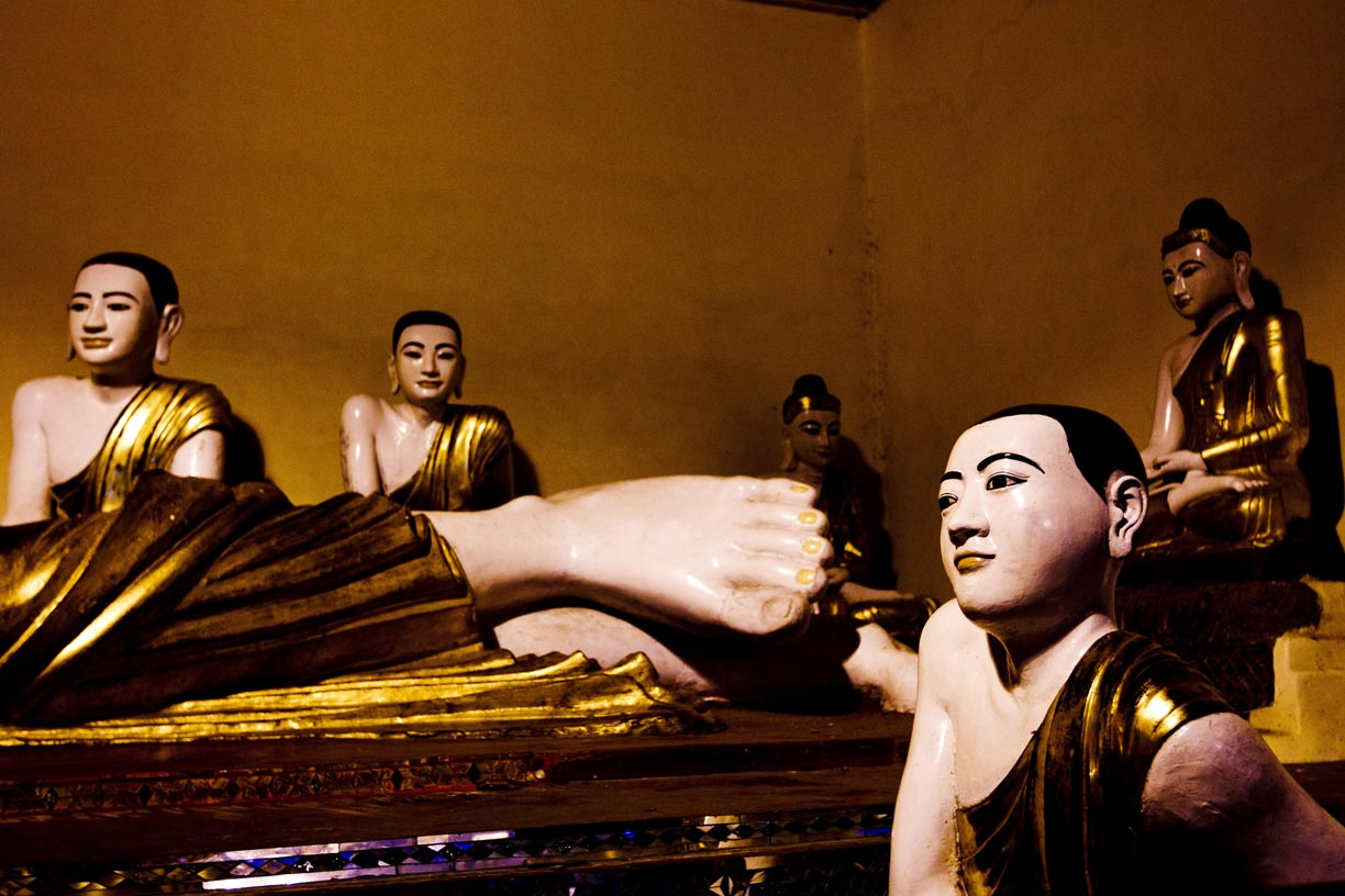Buddha statues sit in a room at the Shwedagon Pagoda.