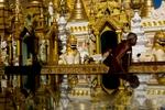 A Buddhist monk walks past the Shwedagon Pagoda.