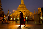 A Buddhist monk walks inside the Shwedagon Pagoda complex in Yangon, Myanmar.