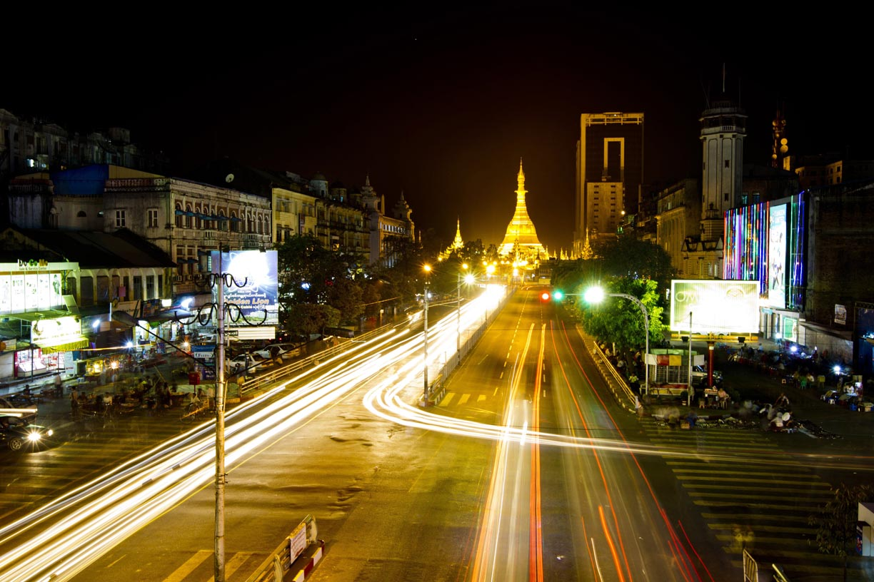 Traffic passes Sule Pagoda.