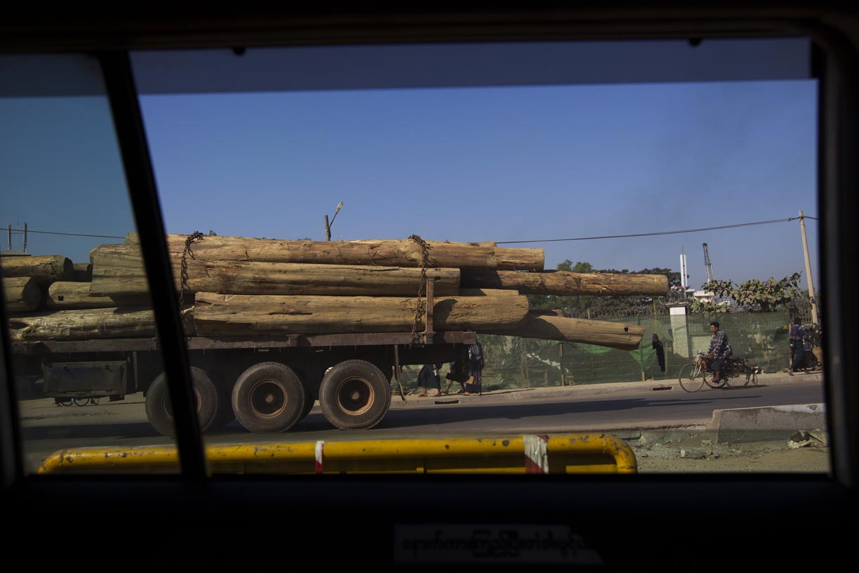 A truck transports logs in the Yoma mountain range.
