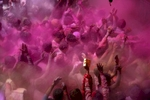 Revellers celebrate the Holi fesitval of colours at the Banke Bihari temple in Vrindavan, India.