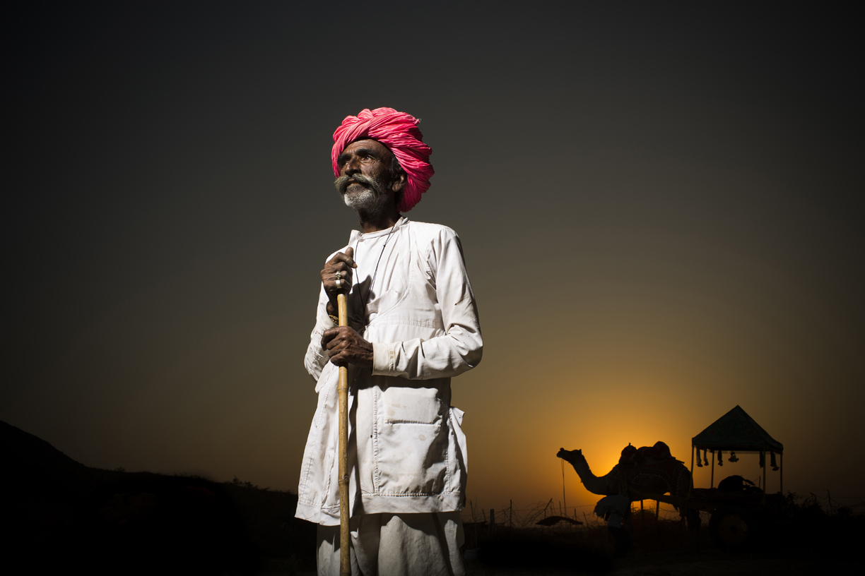 A camel trader poses for a photo in Pushkar.