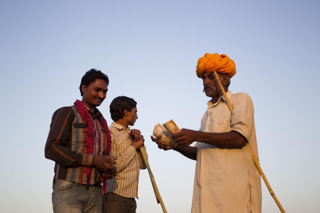 Camel traders bargain in Pushkar.