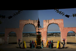 Hindu pilgrims are reflected on glass in Pushkar.