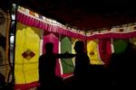 Camel traders bargain inside a tent in Pushkar.
