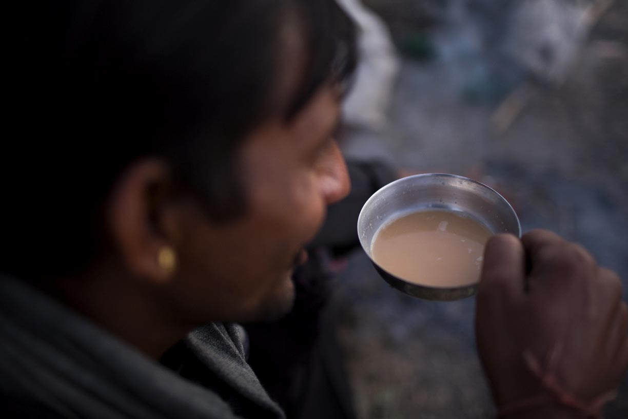 A trader drinks tea with camel milk in Pushkar.