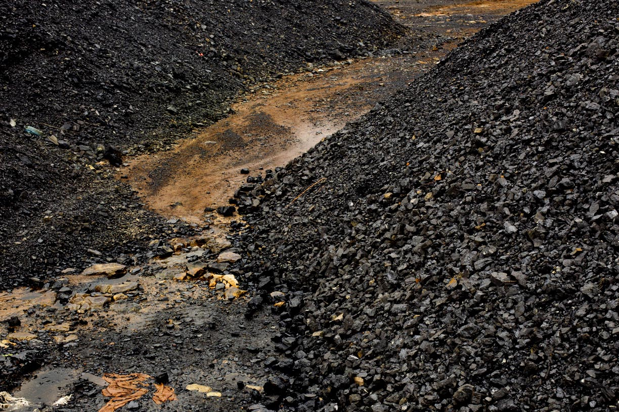 Mountains of coal stand at a transfer station in the Jaintia Hills.