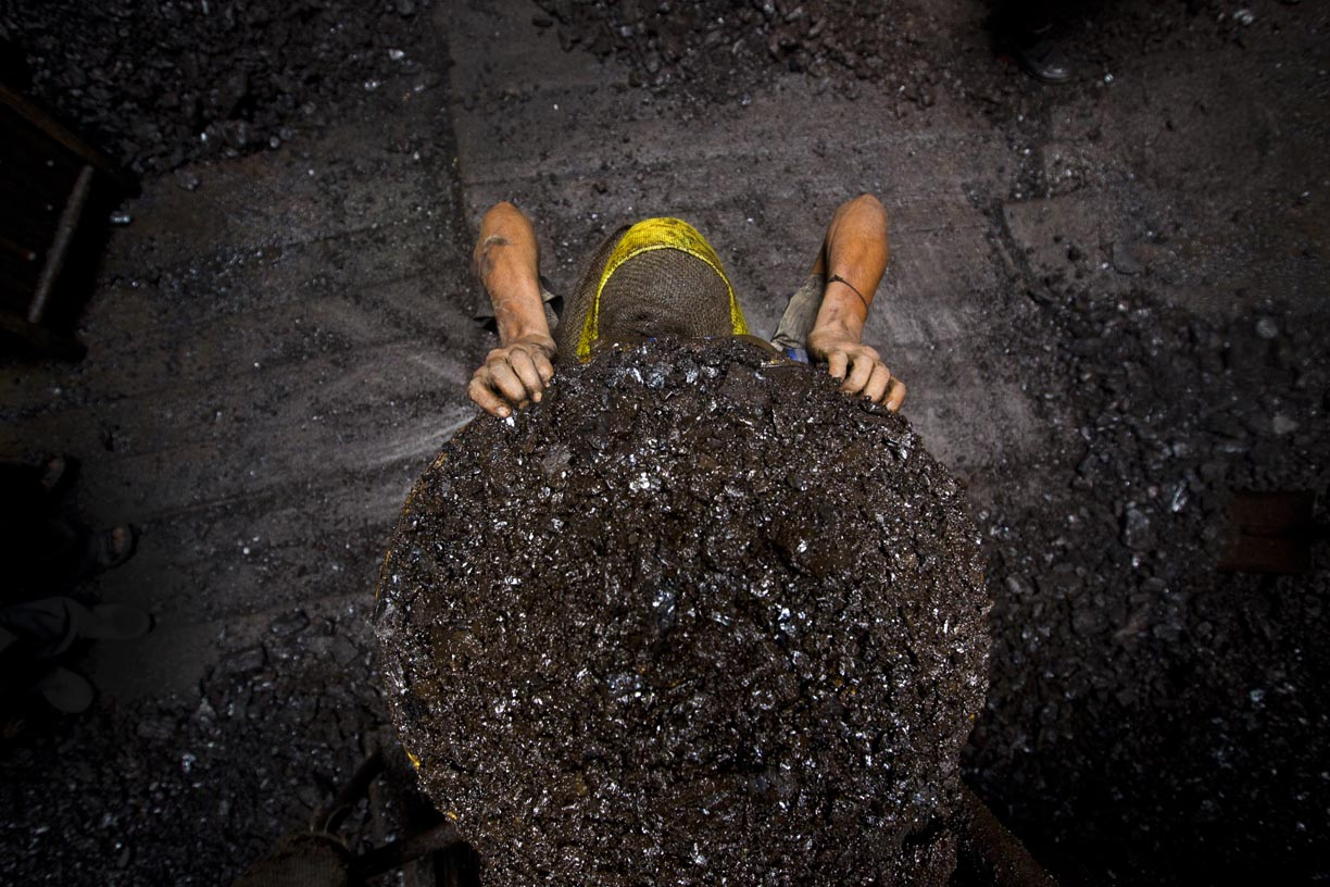 A miner prepares to carry a load of coal to the surface in the Jaintia Hills.